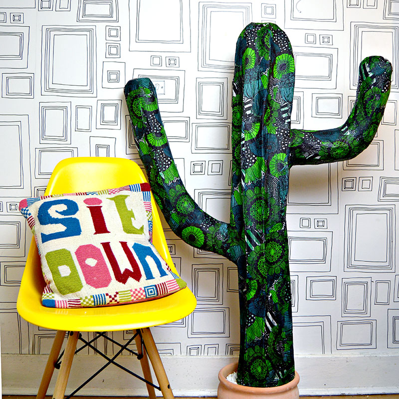 It's easy to make your own giant paper mache cactus.  You can even pimp it with Marimekko napkins.