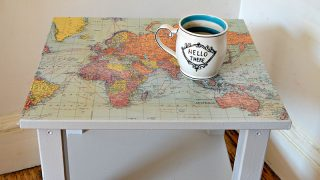 Upcycle a boring Ikea table with a world map and turning it into a fantastic map table.