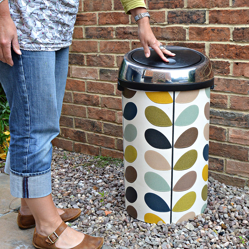 Upcycle  kitchen bin with wallpaper.  This bin was transformed with some Orla Kiely multi stem wallpaper.  No longer need to hide it in the corner the bin is now a feature & no one else will have one like it. Full tutorial.