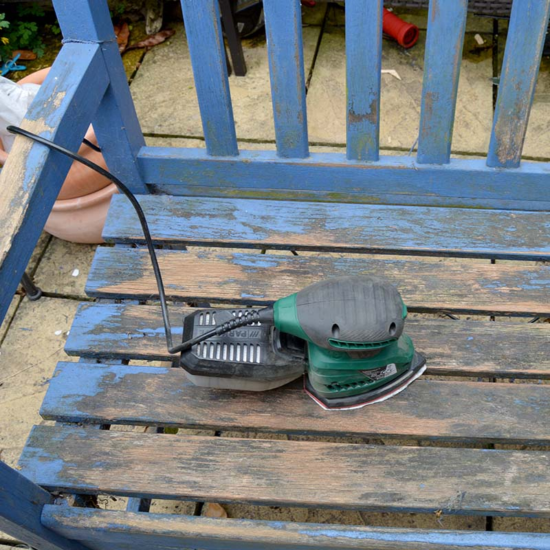 Sanding garden bench ready for decoupage