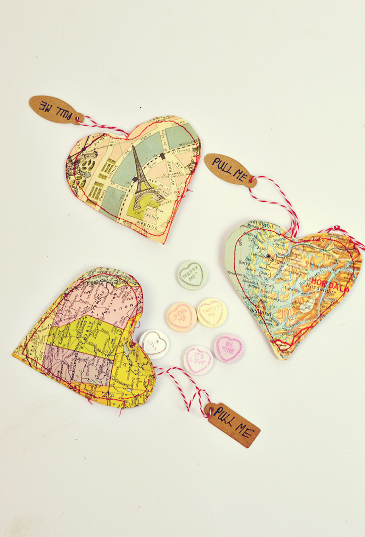 Make personalized heart treat bags by using old maps.  You can use maps of places special to the recipient such as where they were born or where you met.