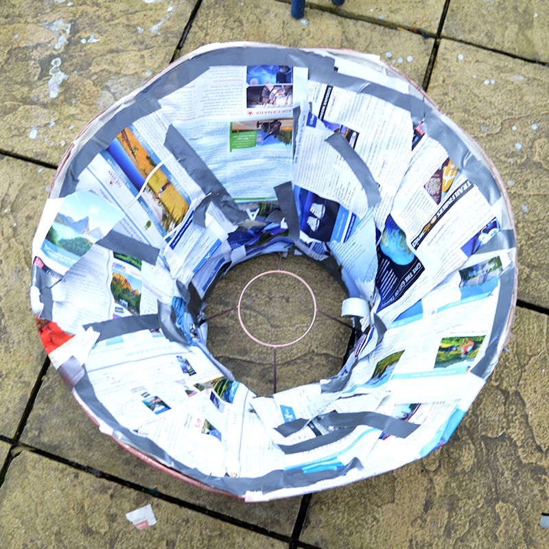 Covering the inside of lampshade with newspaper