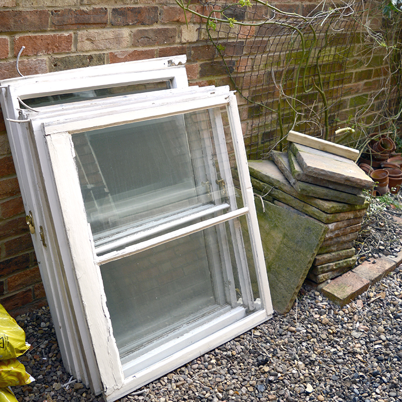 Old sash windows upcycled into herb planter
