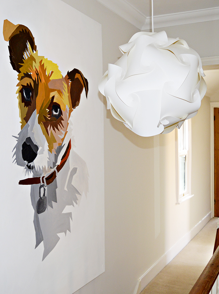 It's easier than you think to paint your own wall art.  Step by step instructions on how to paint a giant portrait with some great tricks.