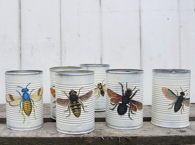 Decoupaged tin cans for upcycled window