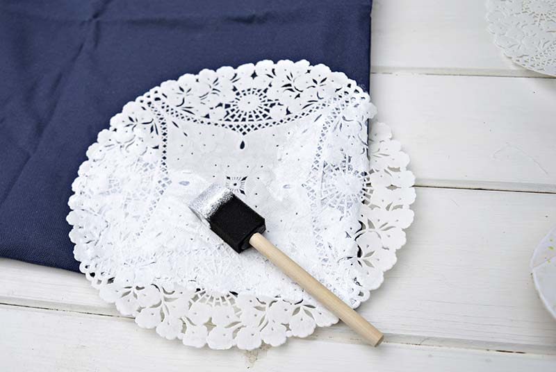 Stencilling a cushion / pillow with a doily