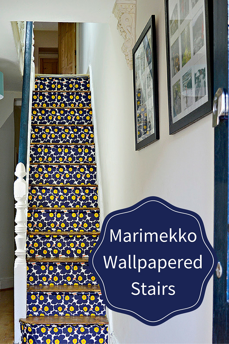 These stairs were transformed with Marimekko Unikko wallpaper.  Full tutorial on how to remove old carpet from stairs and how to wallpaper them for a more striking cleaner look.