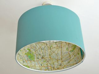 Easy Ikea lamp hack of a rismon lampshade with decoupaged maps.