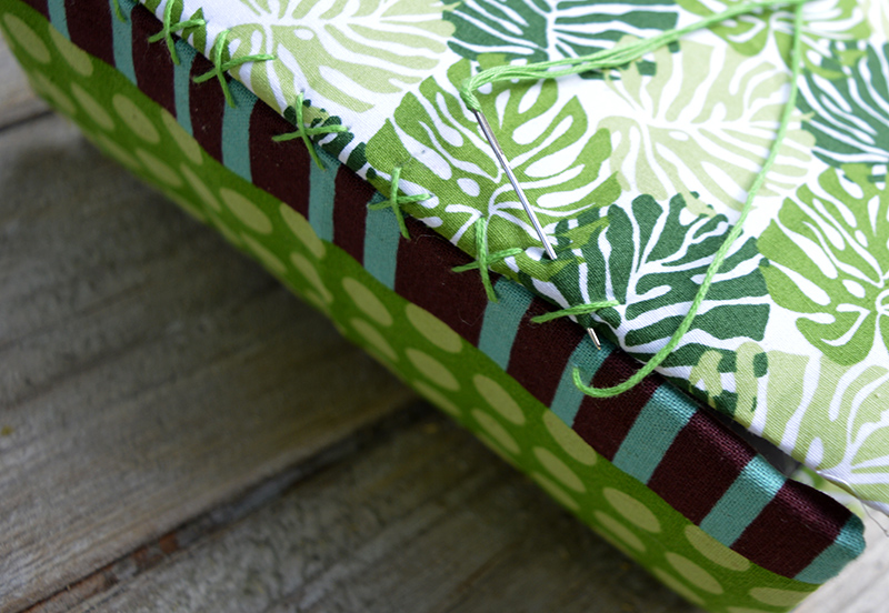 Stitching up the tropical fabric birdhouses