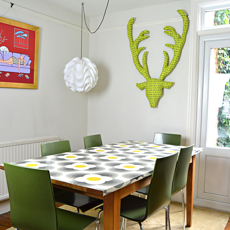 Creative uses for wallpaper - Make your dining table a feature of your home by wallpapering it.