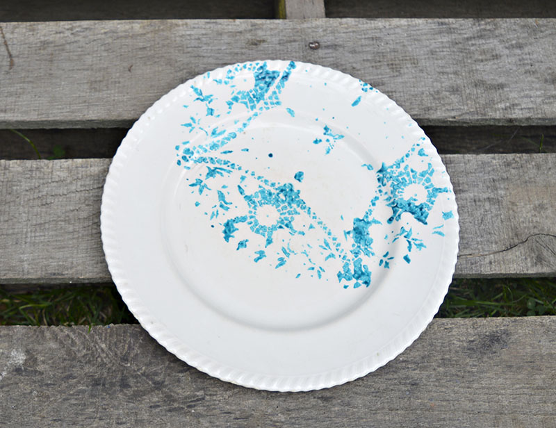 Painted plate- transform an old plate by painting with a doily stencil.