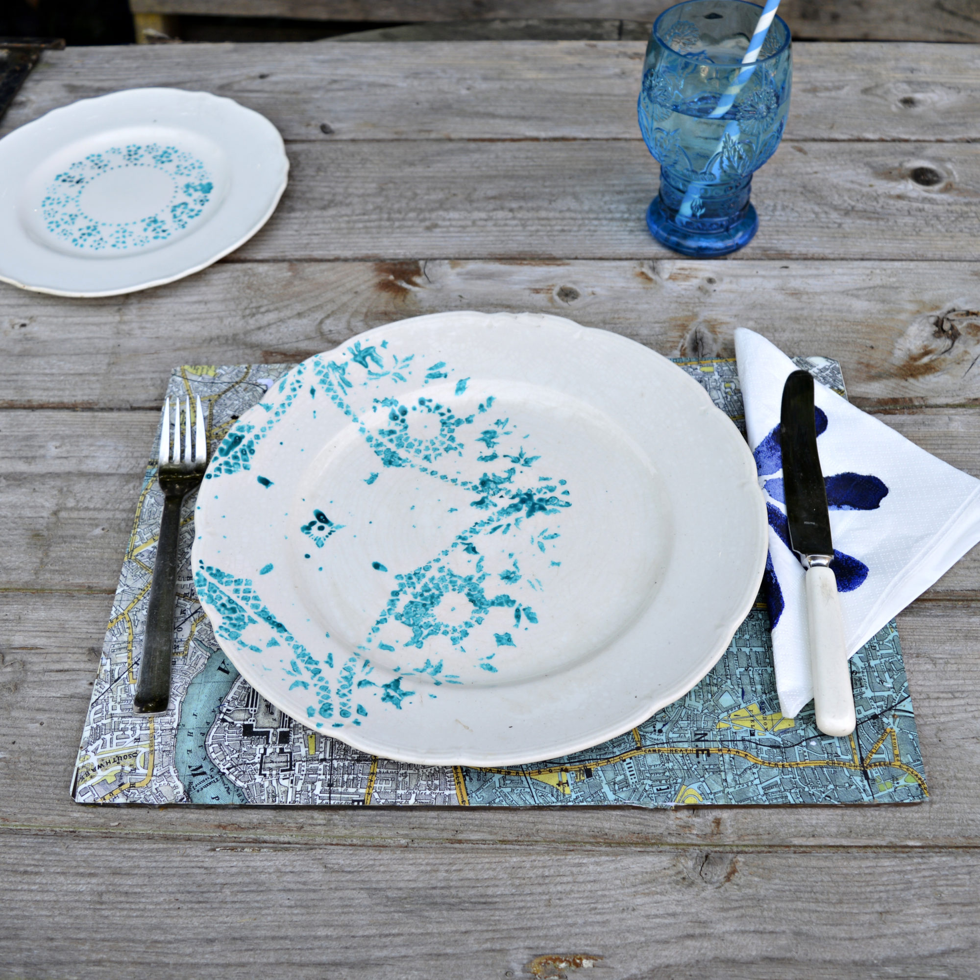 Upcycled vintage painted plate using a paper doily as a stencil.