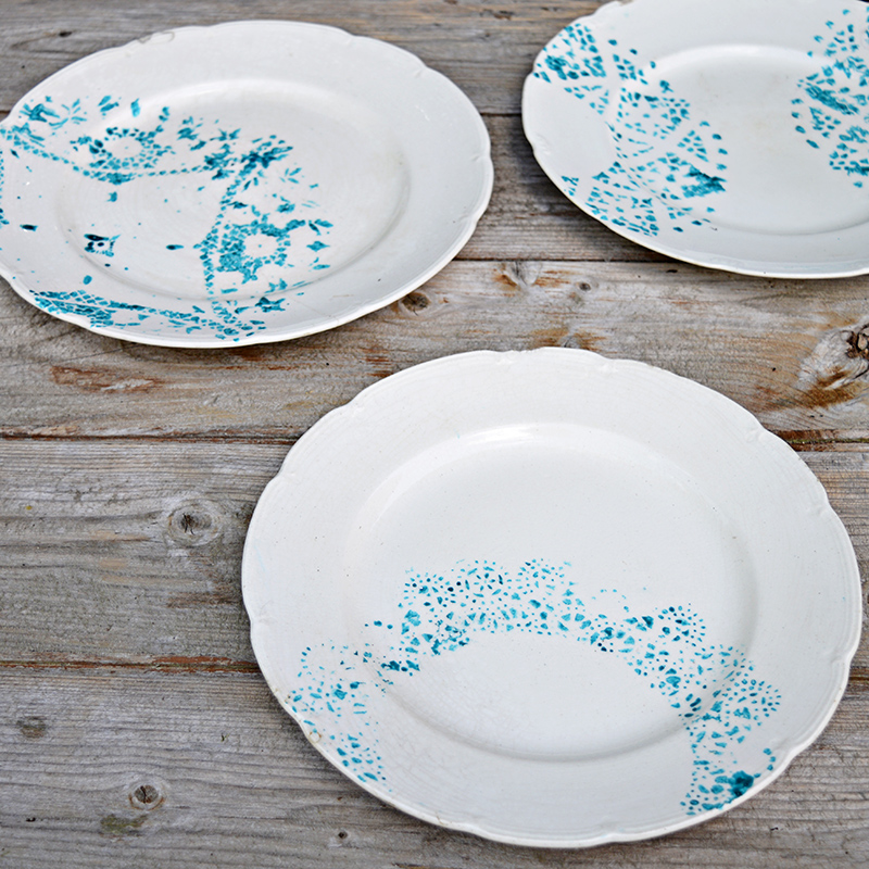 Make a painted plate with a paper doily.  A great way to upcycle and revamp old crockery.