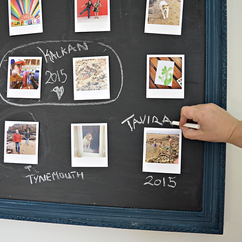 Upcycled picture into a chalkboard photo frame.  A fantastic way to display your photo's.  Not only can you move them around easily but you can also write your own tags on the board.