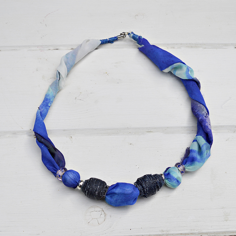 Make your own DIY Jewelry from upcycled scarfs and denim beads. Full tutorial.