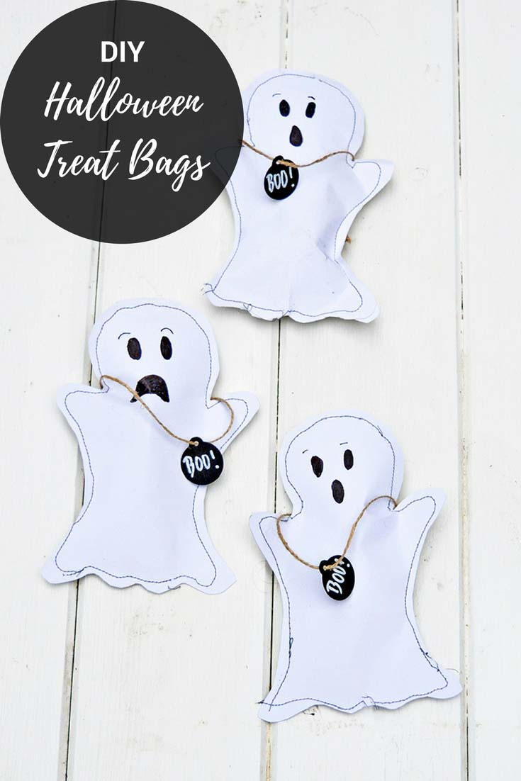 These gorgeous ghost halloween treats bags are so easy to make.  Full instructions with free template, great to give out at Halloween parties and to use as decoration.