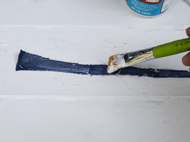 pasting the denim strips