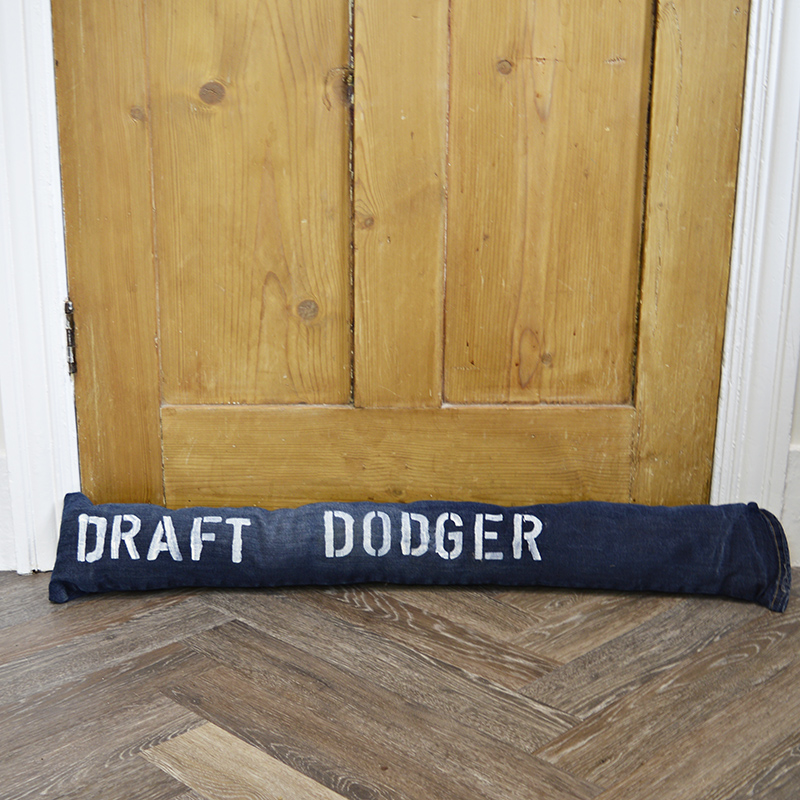 Fun stenciled upcycled denim DIY draught excluder to keep out the cold from door gaps. (Draft Dodger)