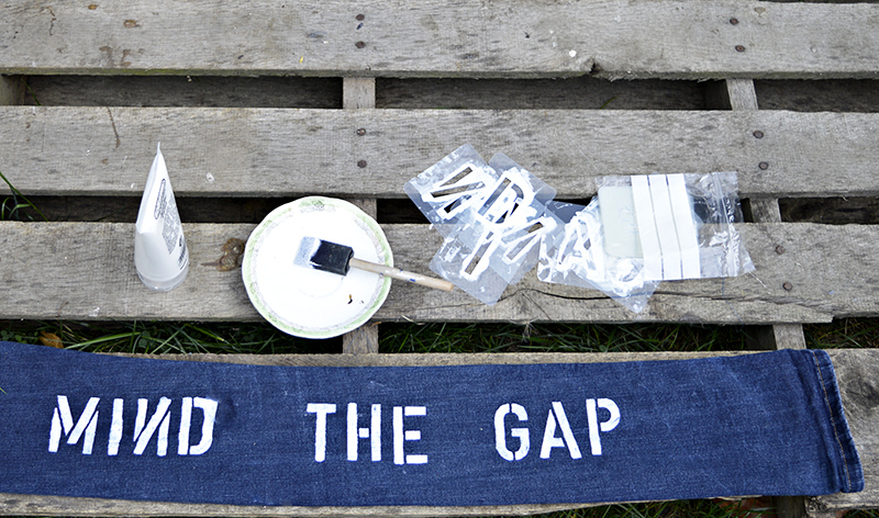 stenciling mind the gap on denim door snake