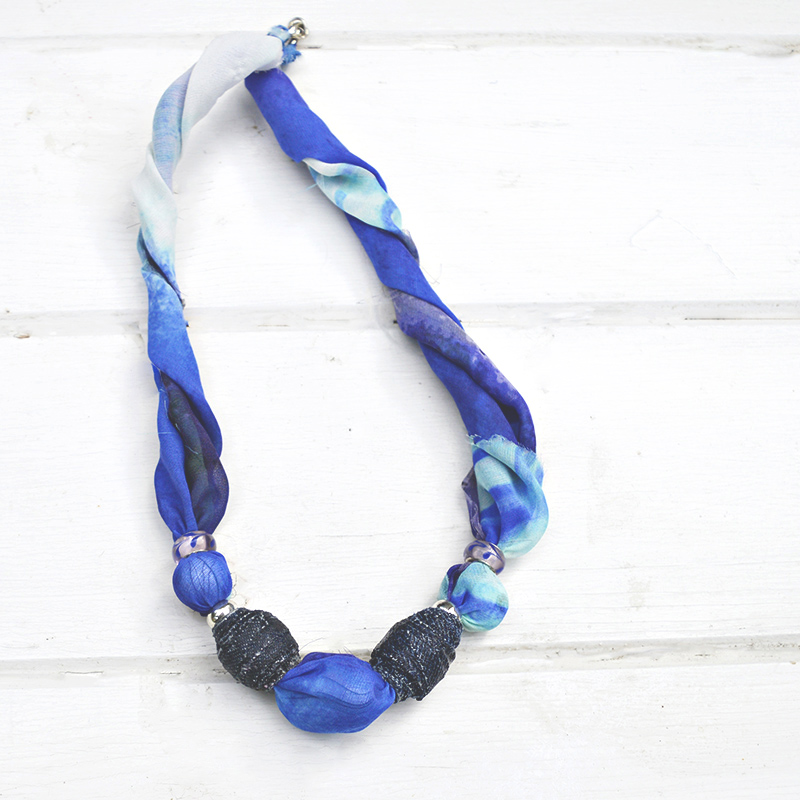 DIY Jewelry by upcycling old scarfs and making denim beads.  Makes a great gift.