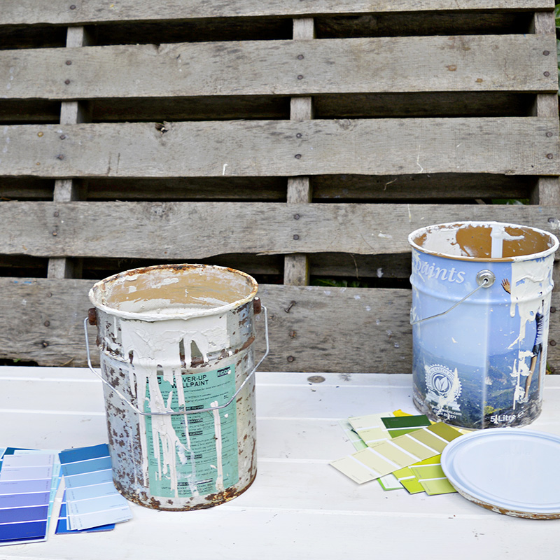 Upcycled empty paint cans with paint chips.  Great colour coded storage for craft room.