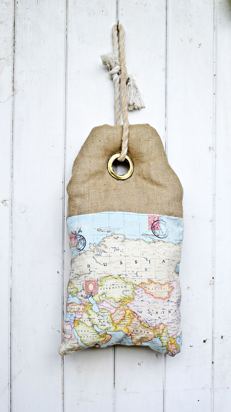 This map burlap pillow looks like a luggage tag. It even has writing on the other side which can be personalized. Full tutorial