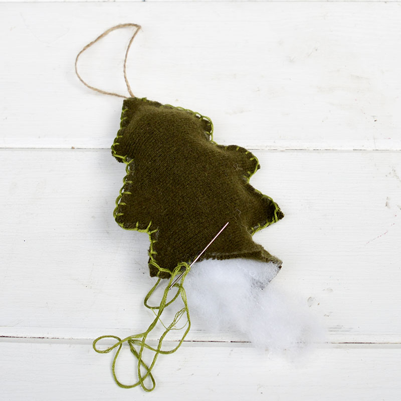 making felt Christmas tree ornaments out of old sweaters
