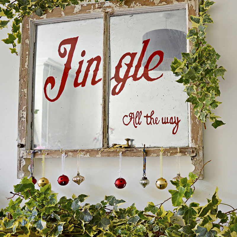 Old window Christmas decoration:  turn an old window into an antique mirror and lovely Christmas decoration for that vintage Christmas look.