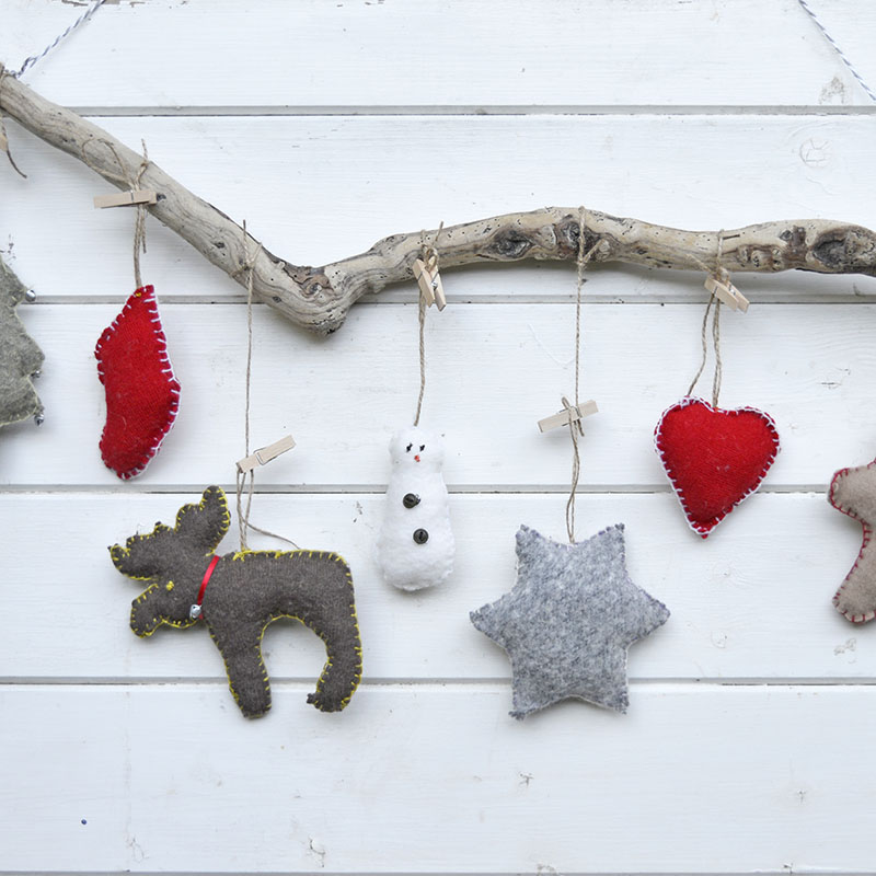 Super cute upcycled Christmas ornaments. Made with old sweaters and cookie cutter shapes. Make for a lovely Christmas wall decoration.