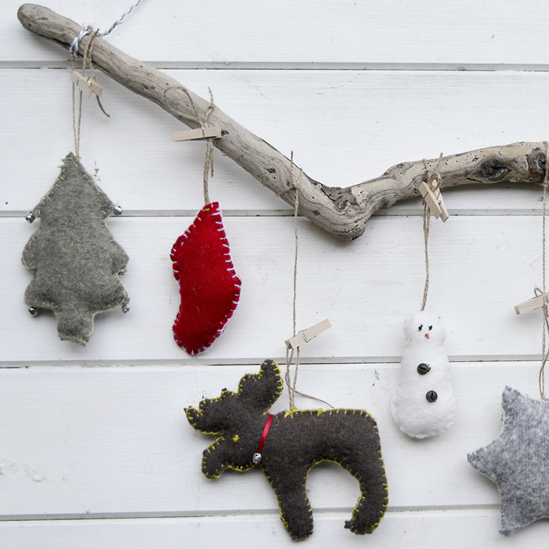 Cute upcycled Christmas ornaments.  Made with old sweaters and cookie cutter shapes.  Make for a lovely Christmas wall decoration.