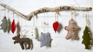 These are super cute upcycled Christmas ornaments. Made with old sweaters and cookie cutter shapes. Make for a lovely Christmas wall decoration.