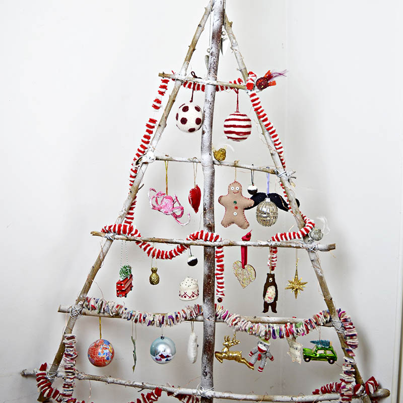 Easy to make your own DIY Christmas tree just using branches from your garden.
