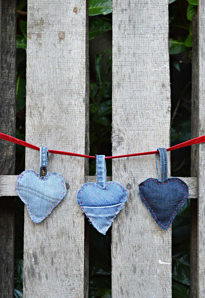 Using a heart cookie cutter as a template upcycle jeans scraps into a gorgeous rustic padded denim hearts garland decoration for Valentine's,  Christmas or everyday.