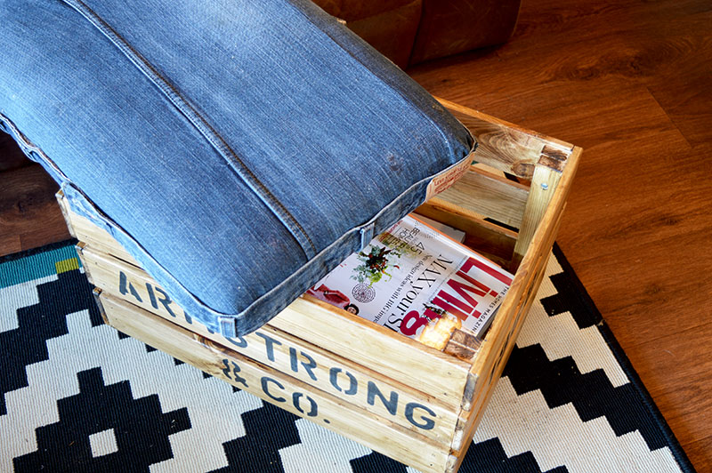 DIY Ottoman from upcycled jeans and an Ikea crate. Makes for handy storage too!