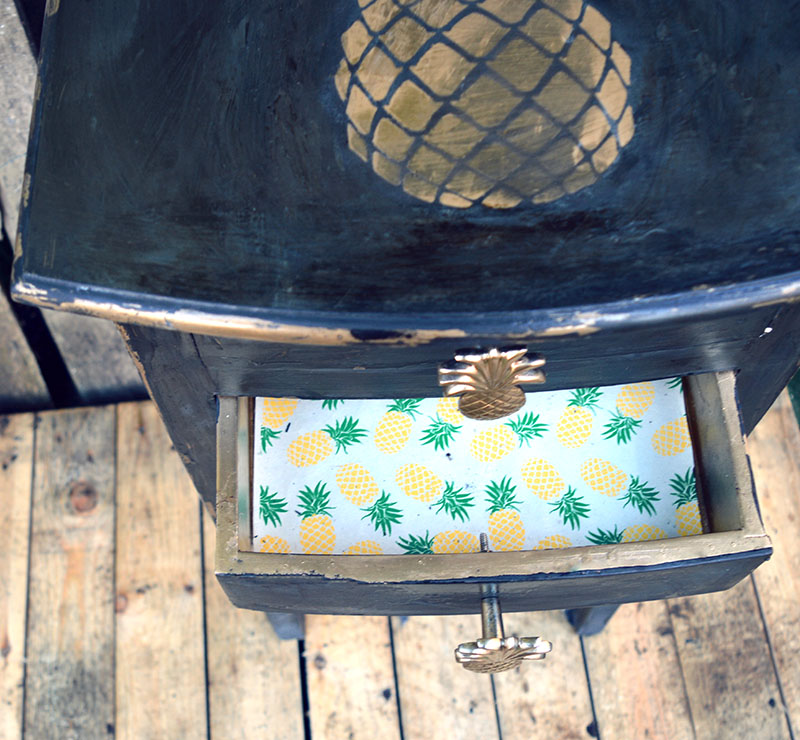 pineapple stenciled table lined draws with pineapple gift wrap