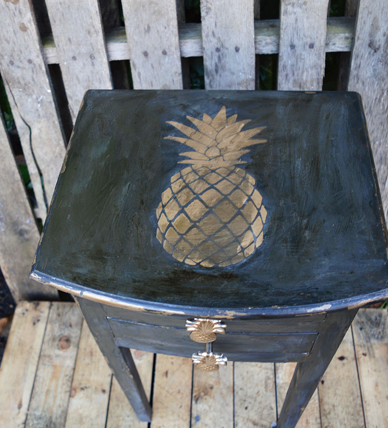Pineapple stenciled furniture.  Upcycled console table with a pineapple theme including, chalk paint pineapple stencils and knobs.