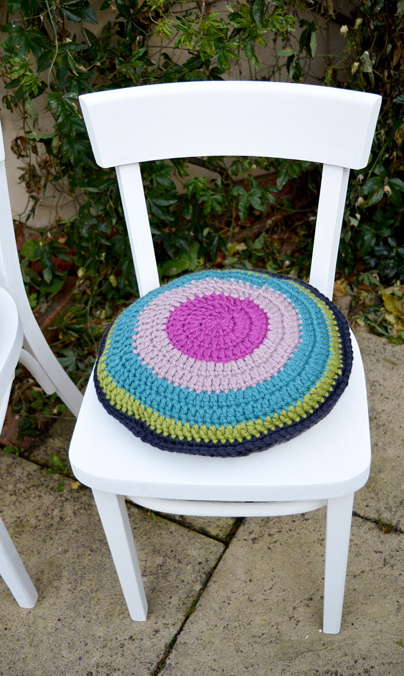 upcycled chair with colourful crochet seat pad.