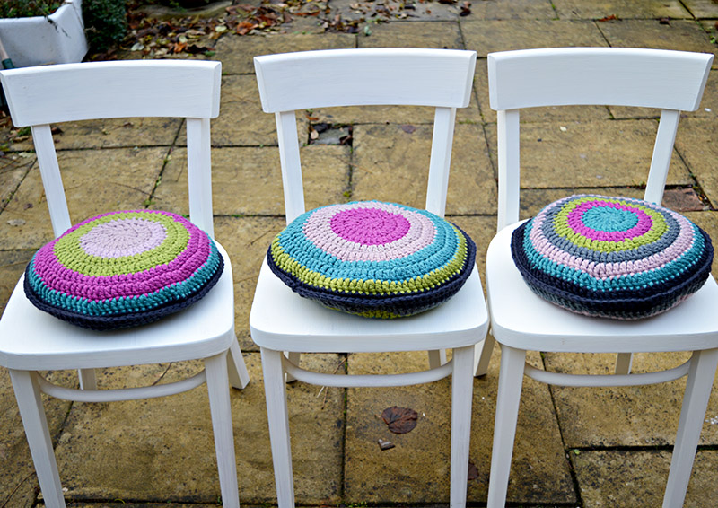 Upcycled Ikea chairs with chalk paint and colorful crochet seat pads.