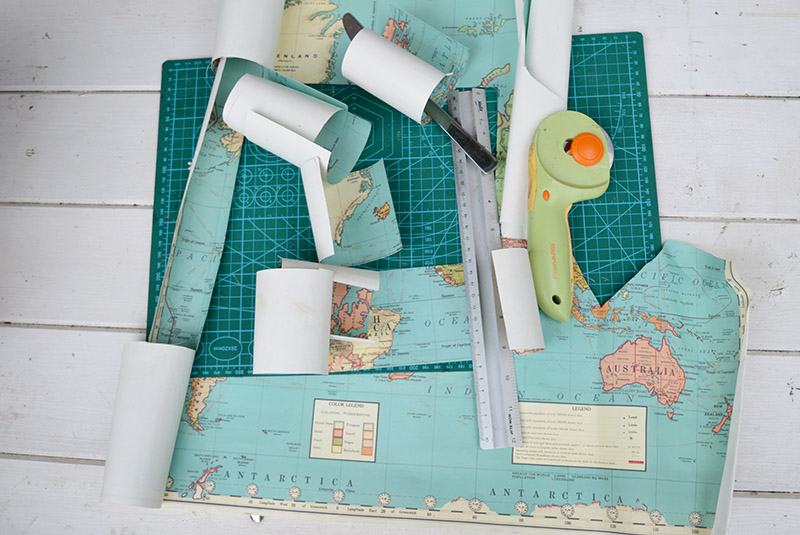 Cutting out the map for decoupage