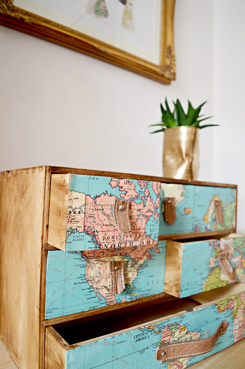 IkEA Moppe hack with maps and leather drawer pulls.