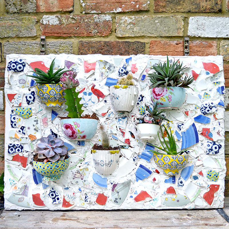 Don't throw away your beautiful broken plates and bowls why not upcycle them into a mosaic wall planter for your succulents or bedding plants.