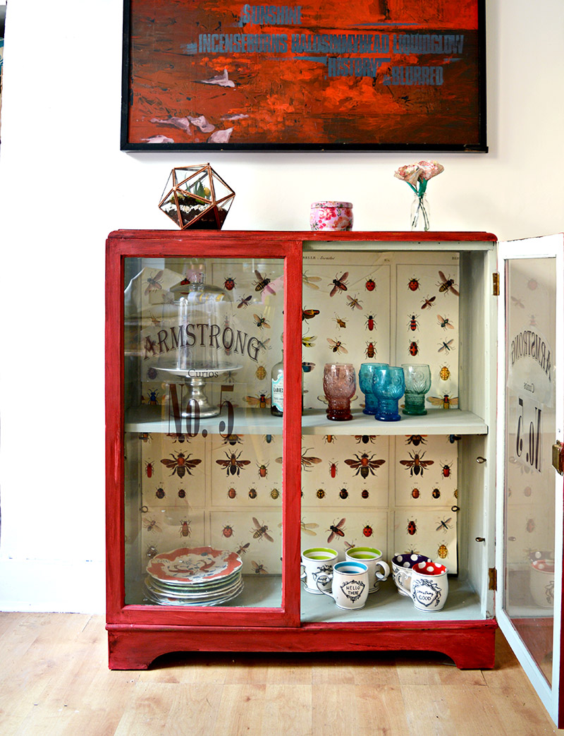 The best chalk paint cupboard upcycle with Annie Sloan Red Emperors Silk, decoupaged vintage graphics (Cavallini's insect wrap) and printable window decals.  Full tutorial.
