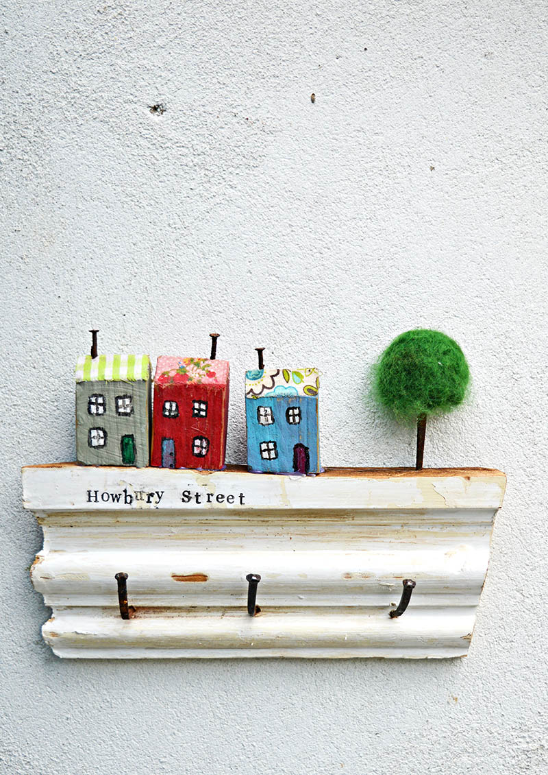 Make a cute wall key holder out of scrap wood from your house and stamp your street name on the rack.  For a unique cute quirky and useful key rack.