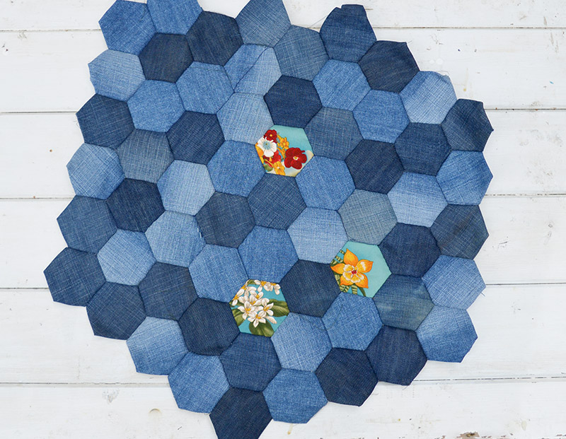 Denim patchwork hexagons using English paper piecing method for a seat cover.  For Denim upholstery