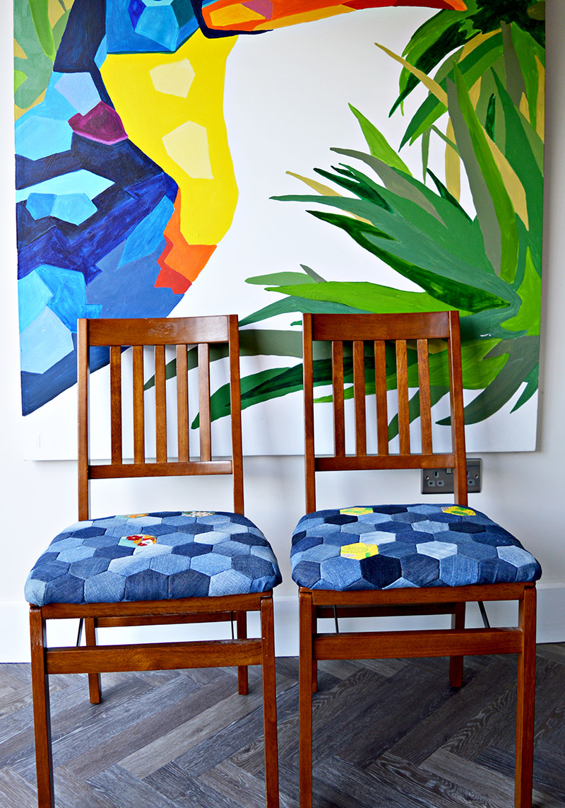 Denim patchwork chairs made from upcycled old jeans using hand sewn denim hexagons.  Full tutorial.