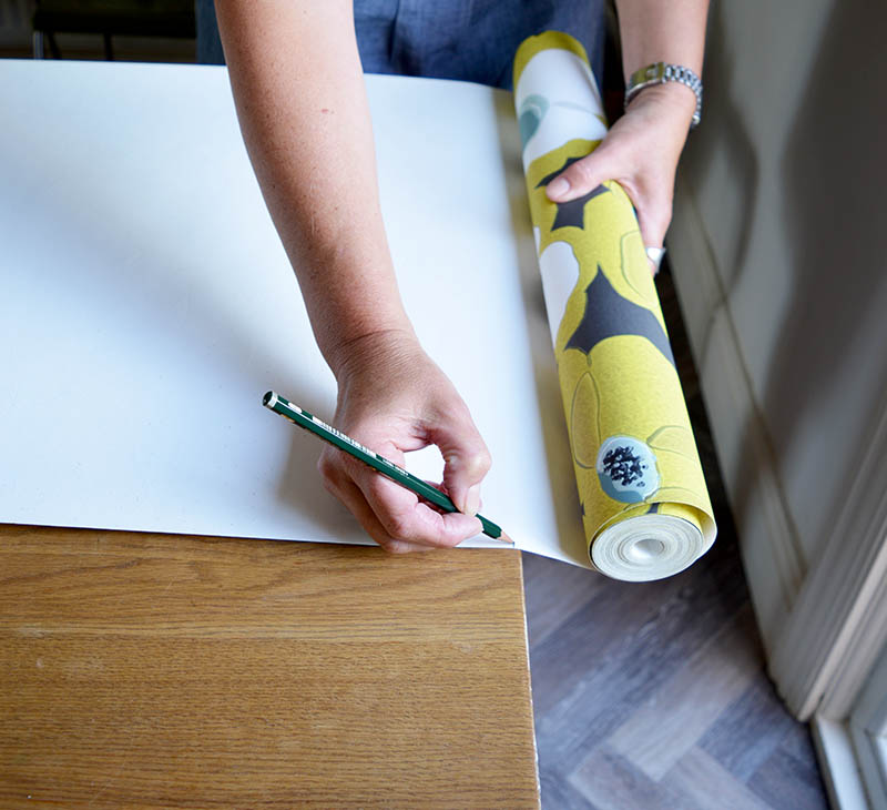 Center Your Wallpaper Roll In The Middle Of Table Top And Measure Length Using A Rotary Cutter Mat Cut