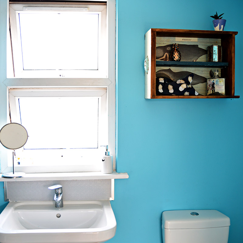 Using upcycled drawers to make a really handy but sweet wall cabinet for a bathroom.
