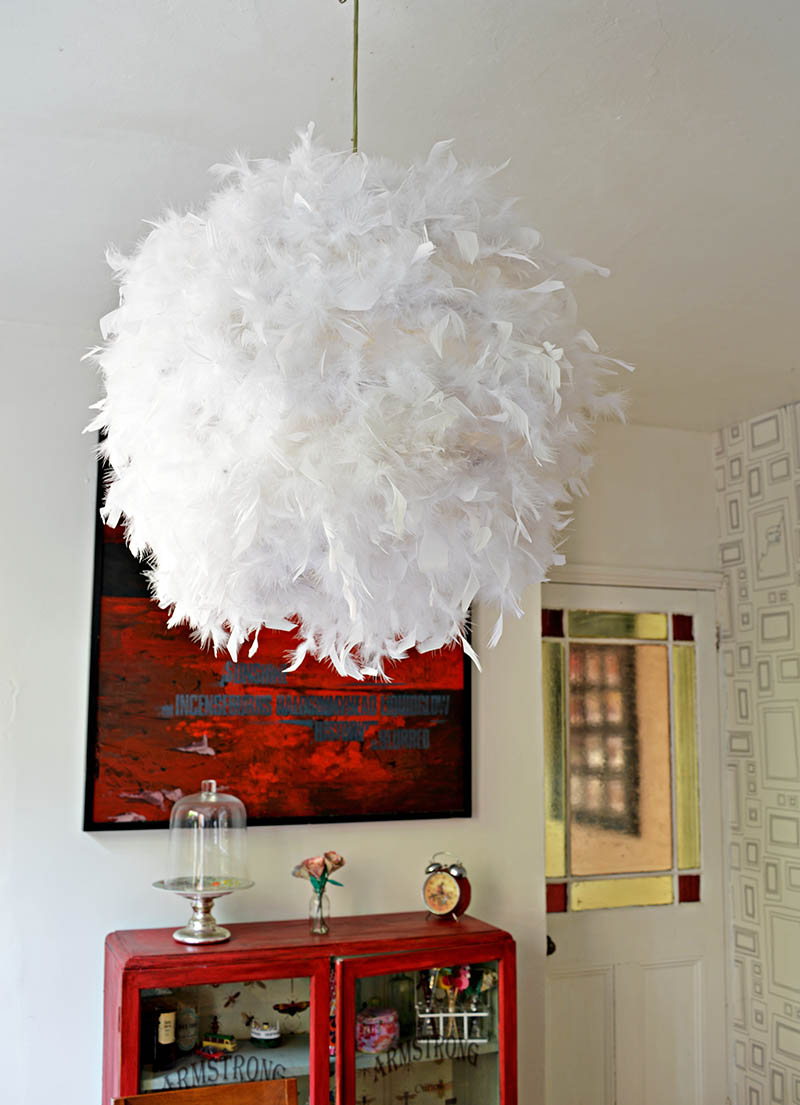 gorgeous DIY feather lampshade.  simple IKEA hack