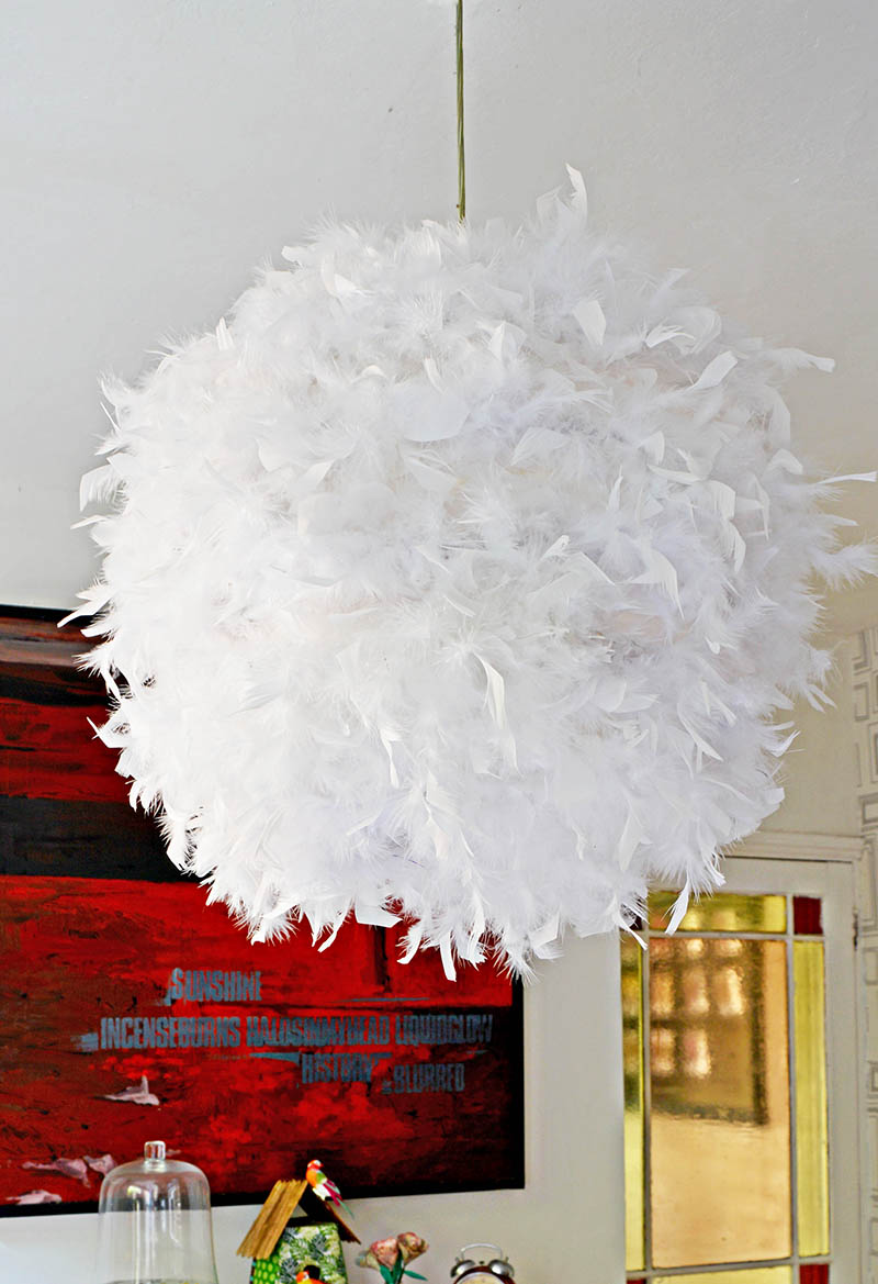 Make your own gorgeous DIY feather lampshade. This simple IKEA hack (Regolit) will add a touch of glamour to a room.