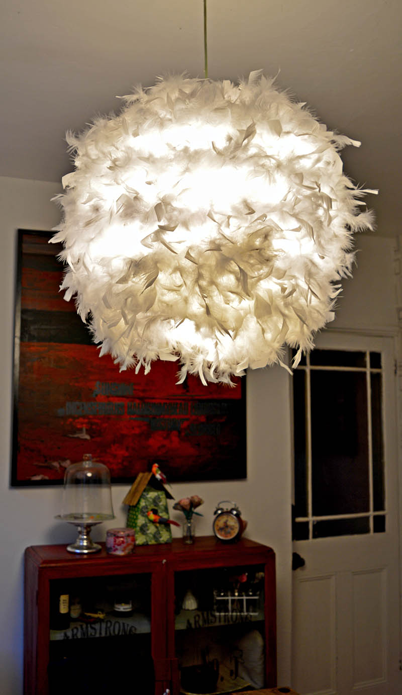 DIY feather lampshade.  This simple IKEA hack (Regolit)  will add a touch of glamour to a room.  It also provides a lovely soft light effect.
